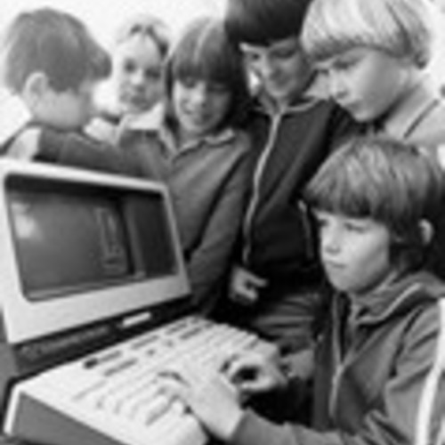 Kevin Hassett, 11, of Macgregor, playing Hangman on a computer terminal at Work in the Future Computer Exhibition at Canberra College of Advanced Education